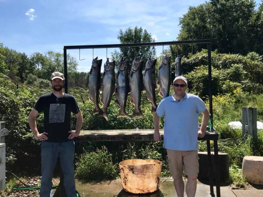 Posing with seven salmon