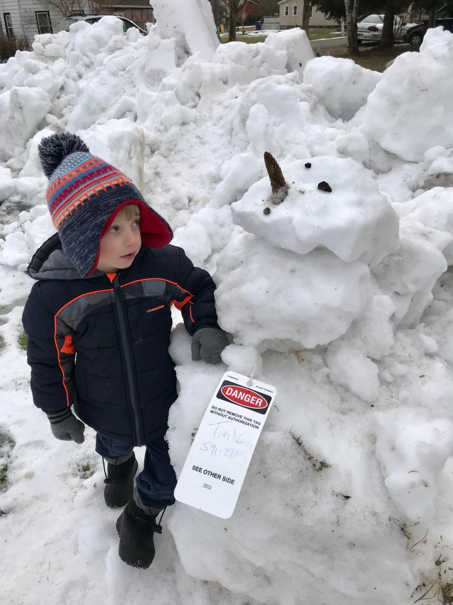 Arius looks at a snowman we built