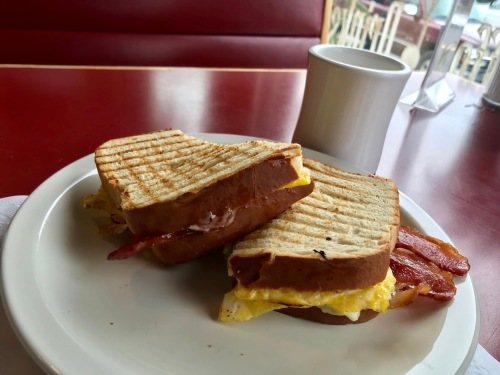 Meat sandwich of eggs, cheese and bacon