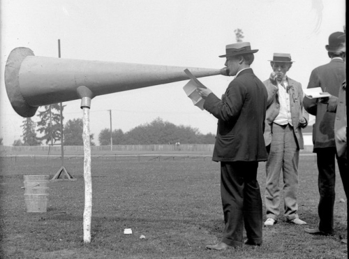 Man with large old-fashioned megaphone