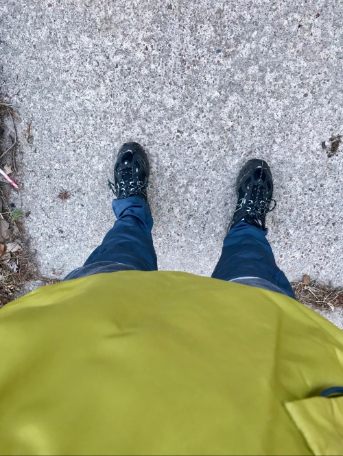 Looking down the author's body: windbreaker, loggings, running shoes