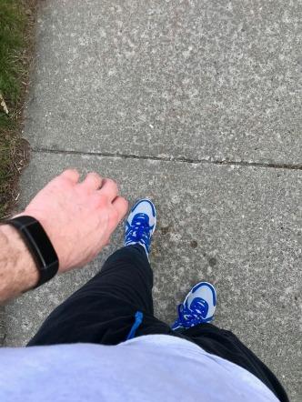 Runner standing in sidewalk