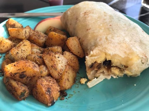 A breakfast burrito with home fries