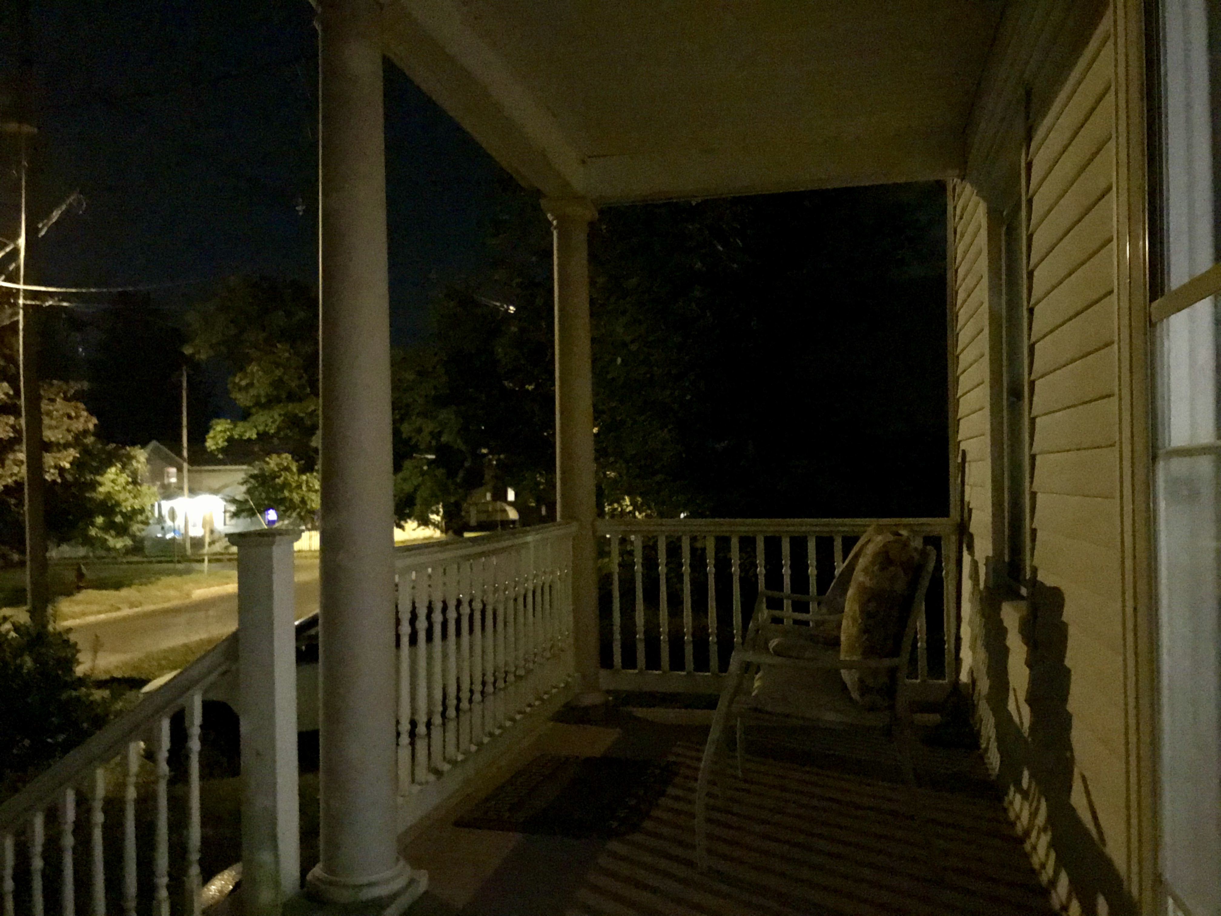 View at dusk of a front porch
